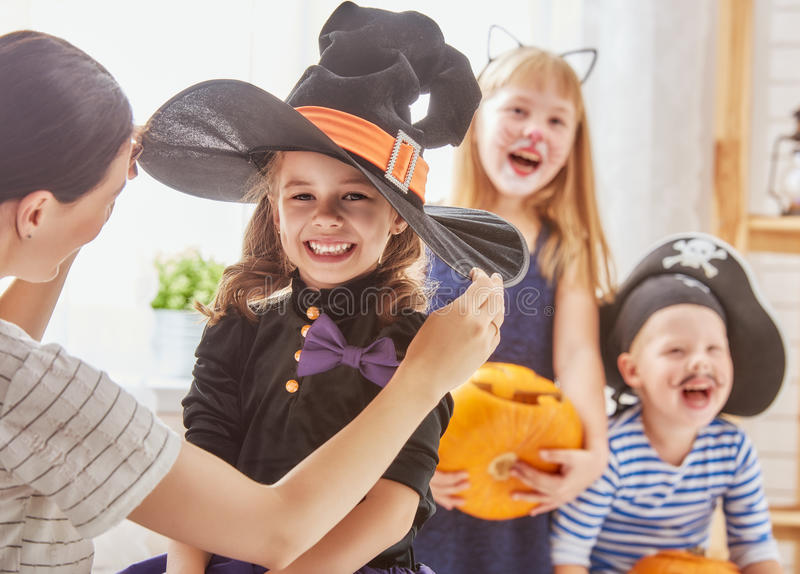 Family prepares for Halloween stock photography