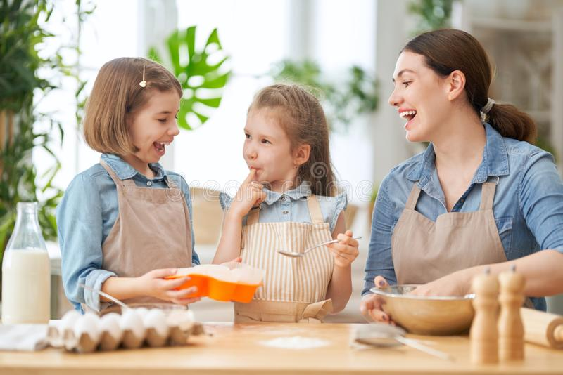Family are preparing bakery together royalty free stock photo