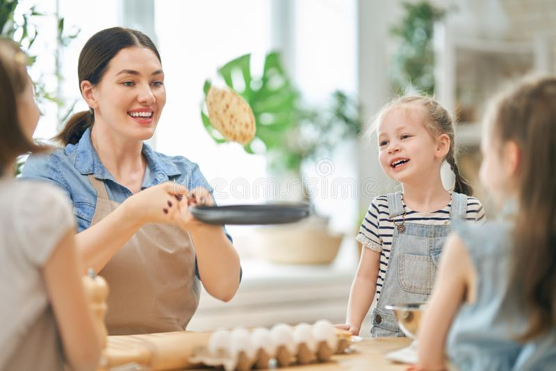 Family are preparing bakery together stock photos