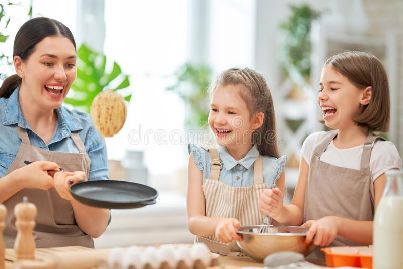 Family are preparing bakery together stock image