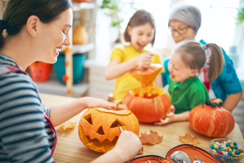 Family preparing for Halloween. Happy family celebrating Halloween. Grandmother, mother and children at home royalty free stock photography