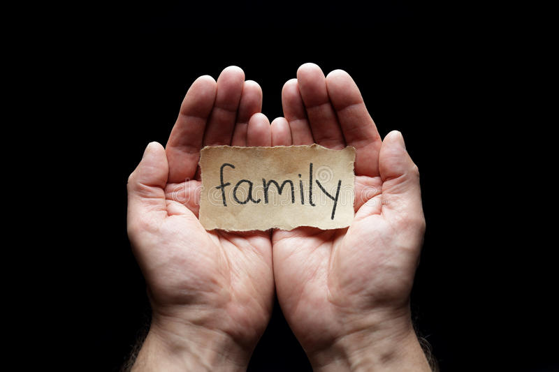 Family protected in cupped hands. Family with the protection of cupped hands, concept for love, health, security and care royalty free stock images