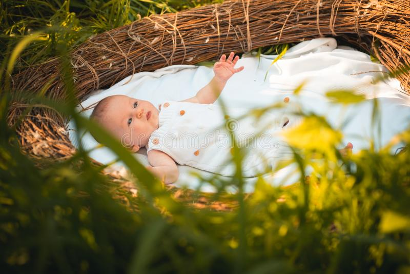 Family psychology. Infant developmentl psychology. Newborn baby in crib. Pediatric care for newborn baby. Family care royalty free stock images