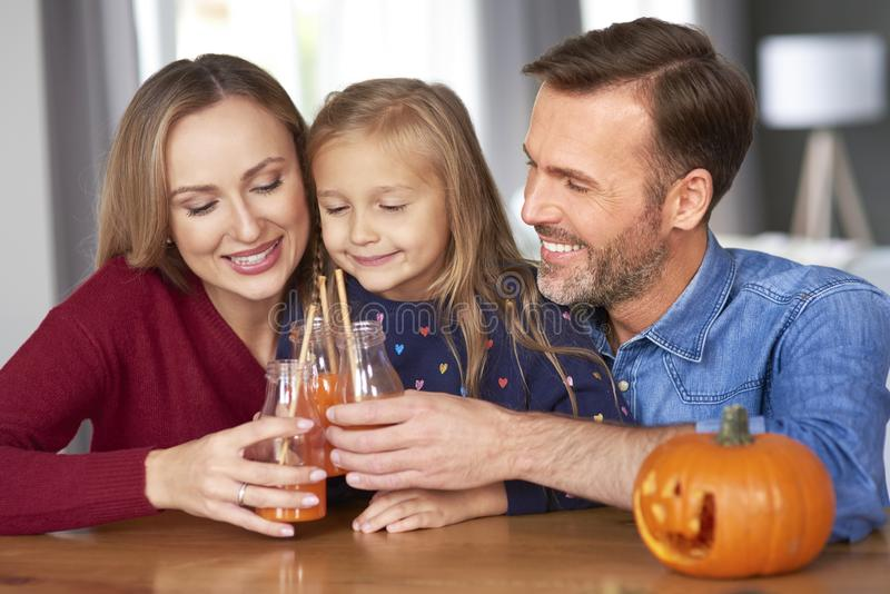 Family making a toast to halloween stock images