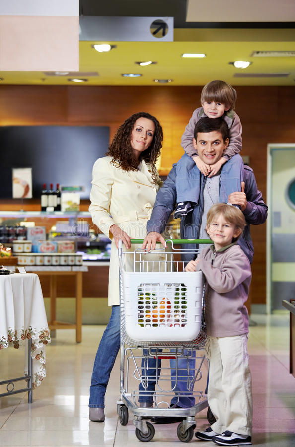 Family with purchases in shop royalty free stock photography