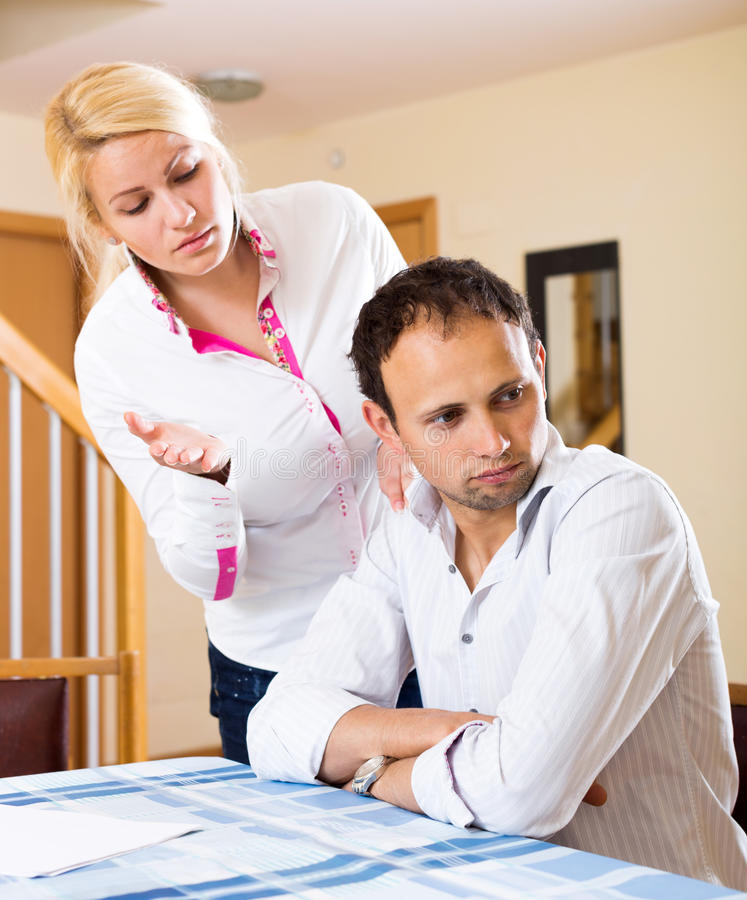 Family quarrel. Couple having problems at home. Focus on the man royalty free stock image