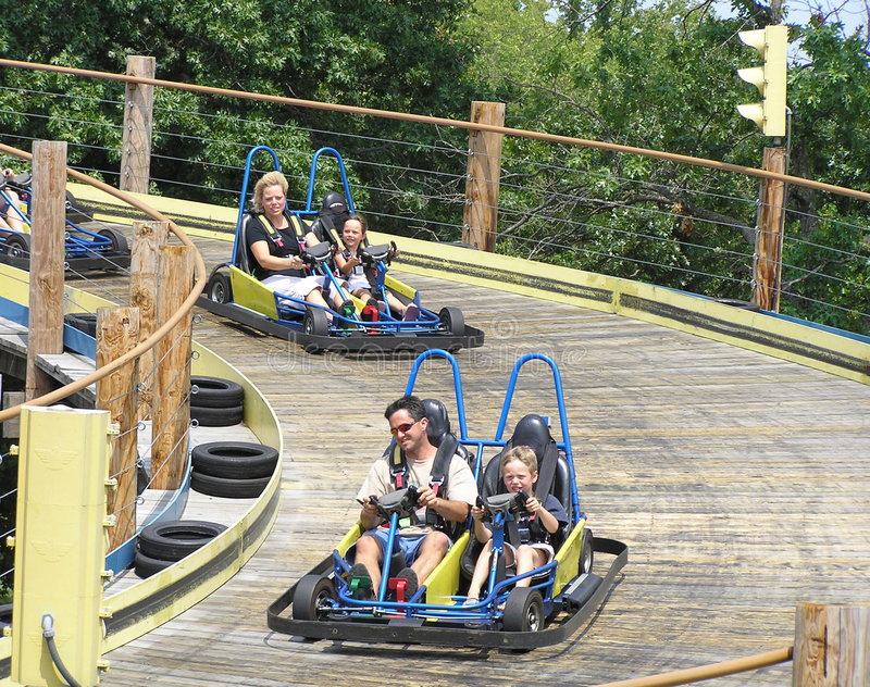 Family Race. Family on vacation races gocarts
