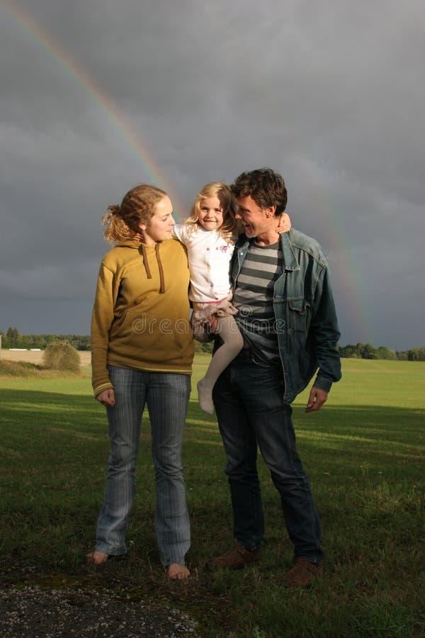 Family and rainbow stock photo