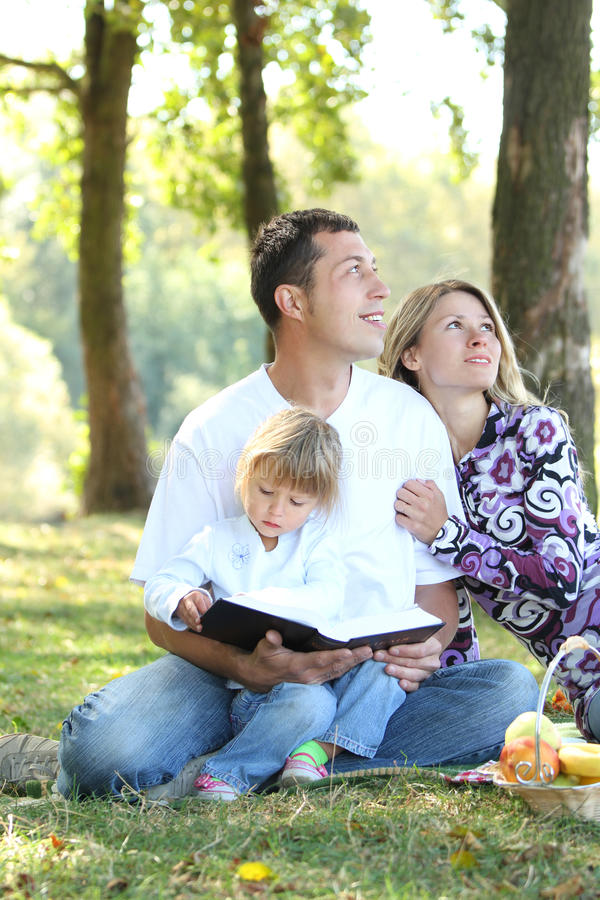 Family Read The Bible In Nature Royalty Free Stock Photos