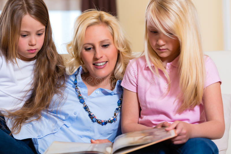 Family Reading A Book Together Royalty Free Stock Image