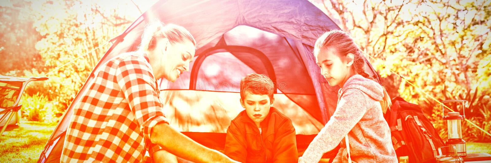 Family reading the map outside the tent royalty free stock photos