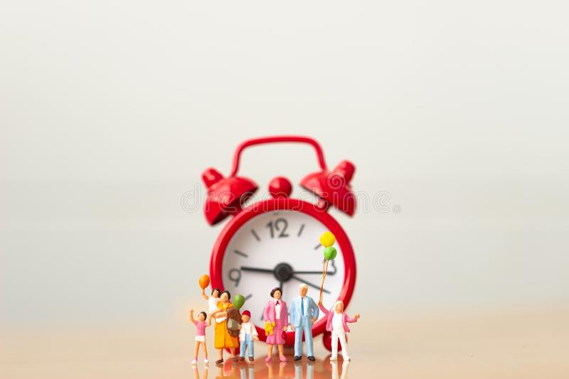 Family and red alarm clock. royalty free stock photo