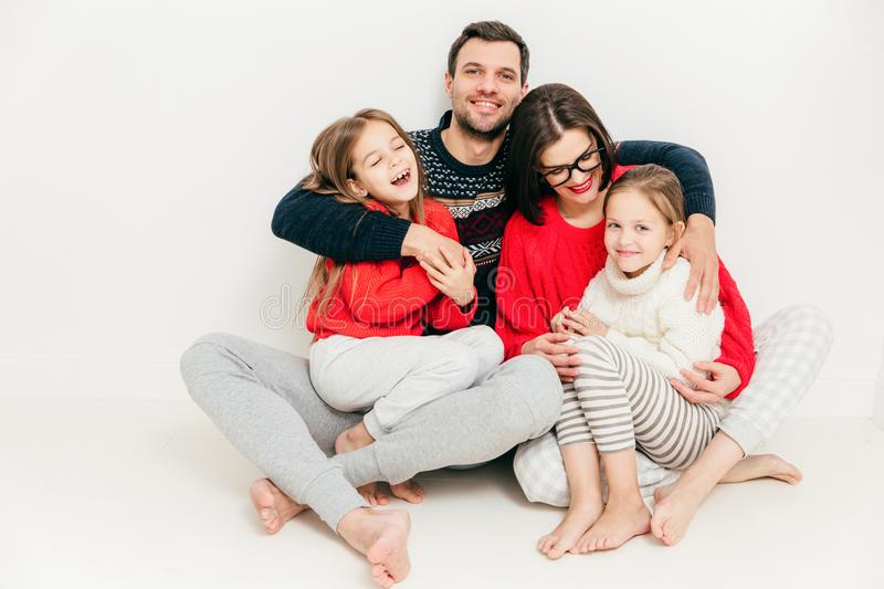 Family relationship concept. Cute cheerful little small girl have fun and enjoy spare time with their parents. Happy male father royalty free stock photography