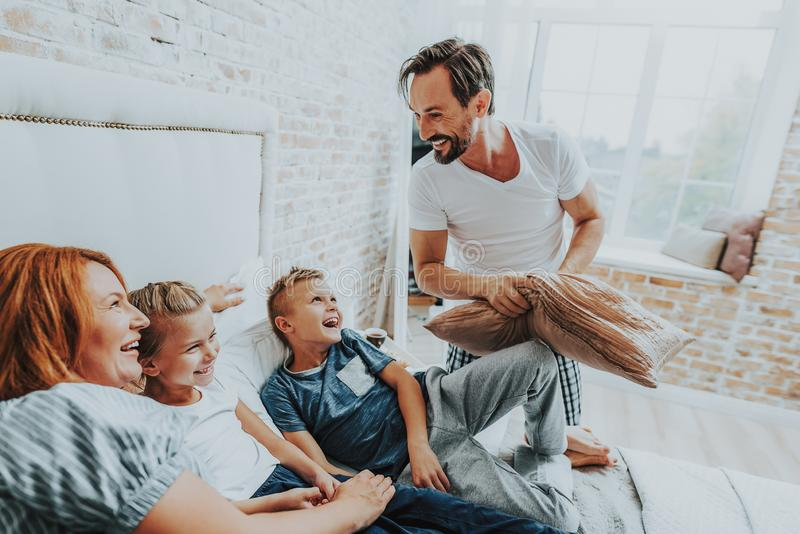 Smiling family having fun together in morning royalty free stock images