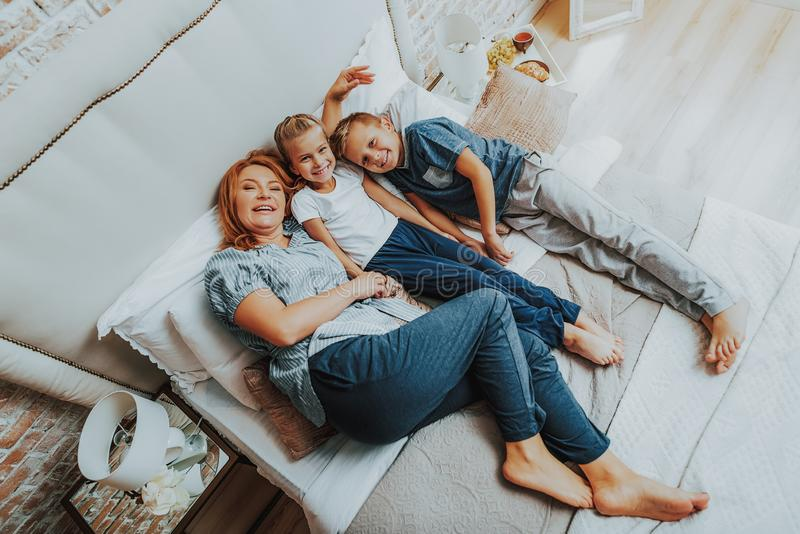 Happy mother spending time with two children stock photo