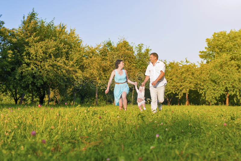 Family and Relationships Concepts. Happy Young Family Running Together royalty free stock photos