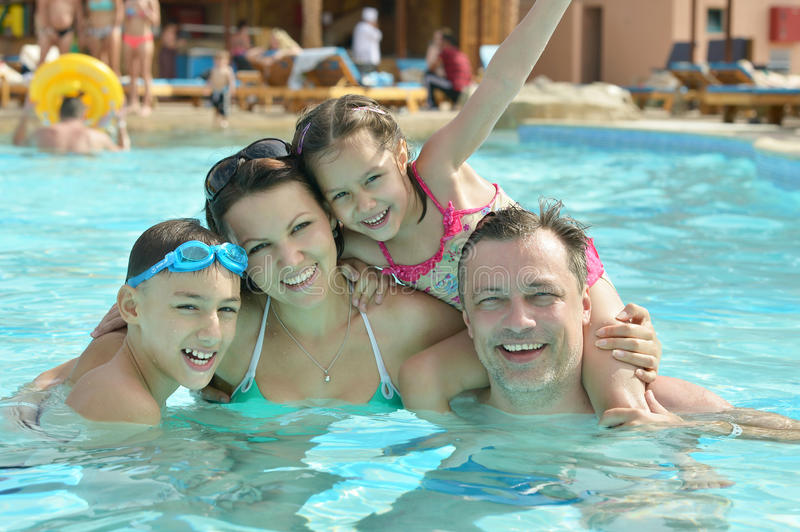 Family relax in pool. Portrait of a happy family relax in the pool stock image