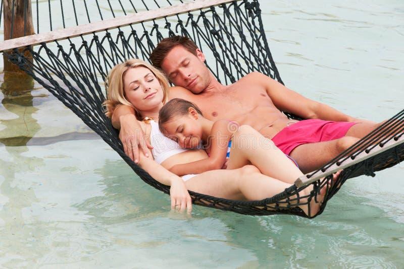 Family Relaxing In Beach Hammock stock image