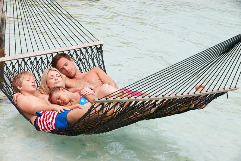 Family Relaxing In Beach Hammock stock photo