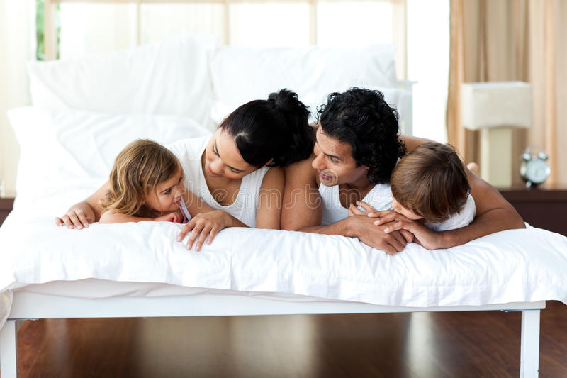 Download Family Relaxing On The Bed Together Stock Image - Image: 12099123