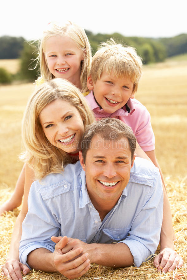 Download Family Relaxing In Summer Harvested Field Stock Photo - Image: 15555036