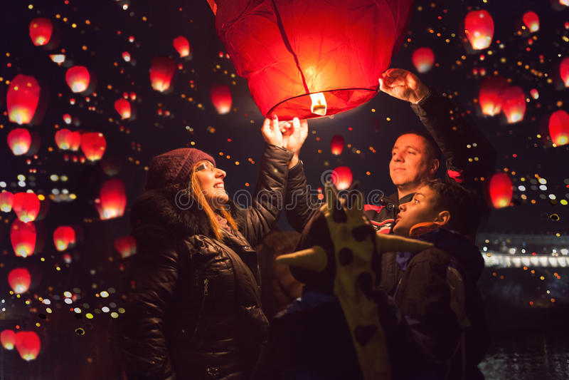 Family release sky lanterns for the humanitarian action, Novi Sa royalty free stock photo