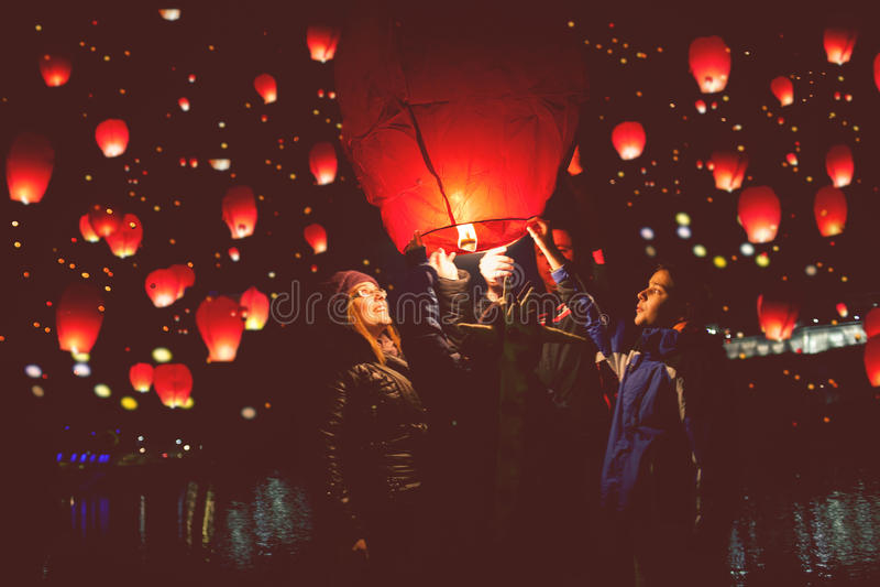 Family release sky lanterns for the humanitarian action, Novi Sa royalty free stock photos