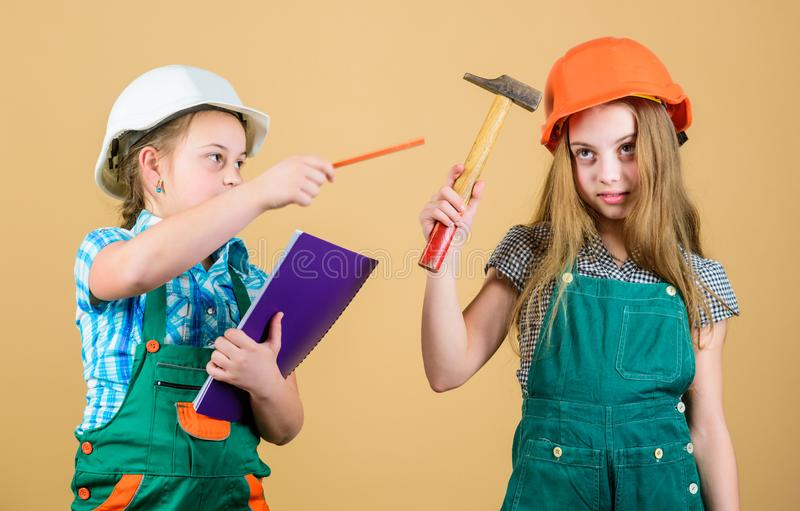 Family remodeling house. Children sisters renovation their room. Control renovation process. Kids happy renovating home stock photo