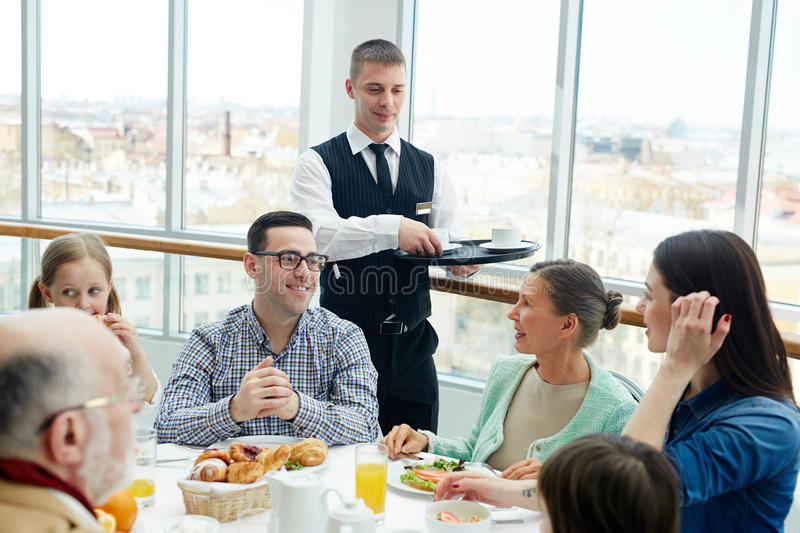 Family in restaurant royalty free stock photo