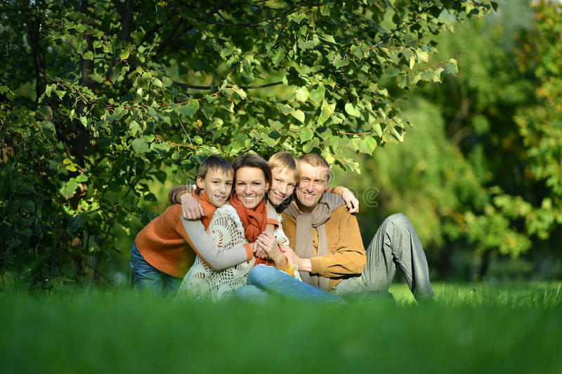Family resting in park stock photography