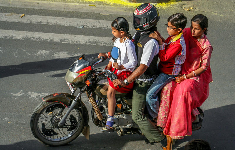 Family ride. Family riding on a motorbike in Jaipur, India royalty free stock photography