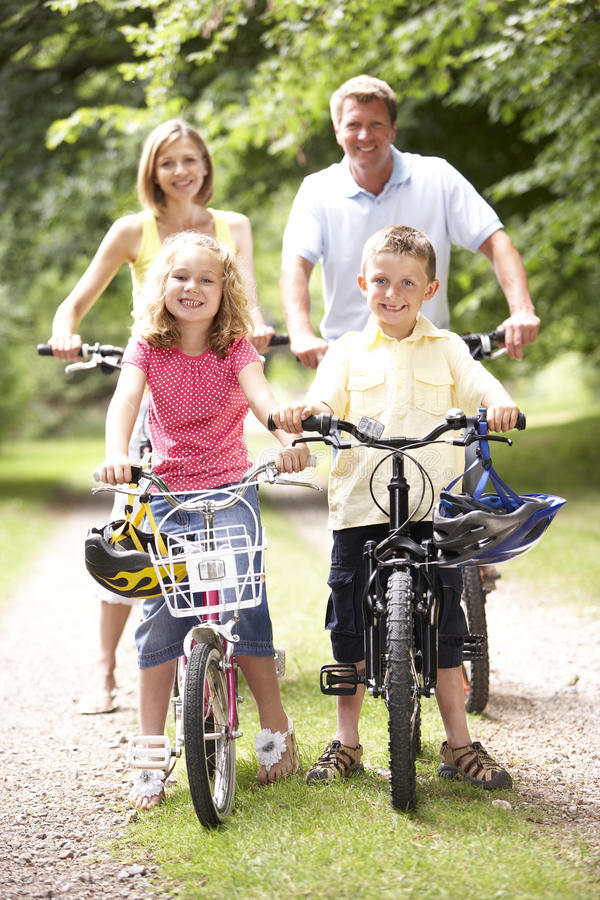 Family Riding Bikes In Countryside Royalty Free Stock Images