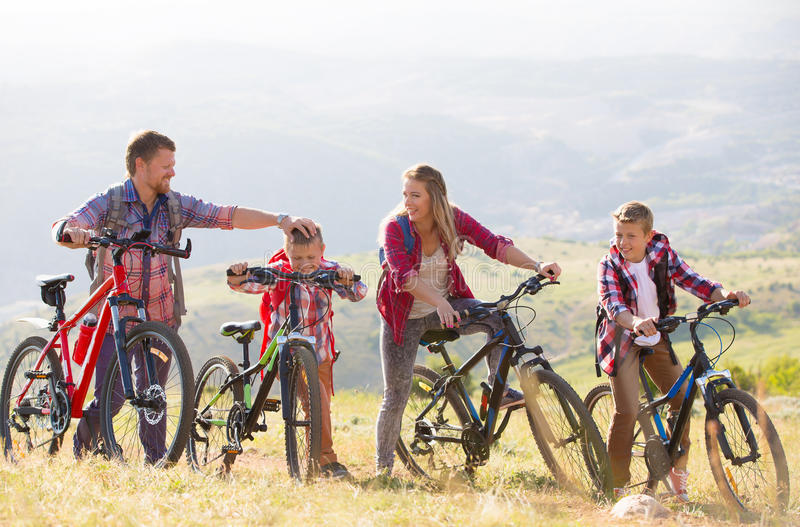 Family riding bikes in the mountains royalty free stock photos