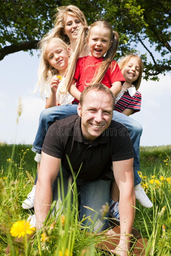 Download Family riding daddy stock image. Image of meadow, relaxed - 15236847