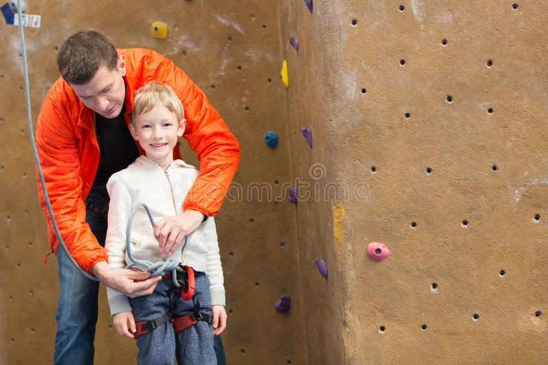 Family rock climbing stock photo
