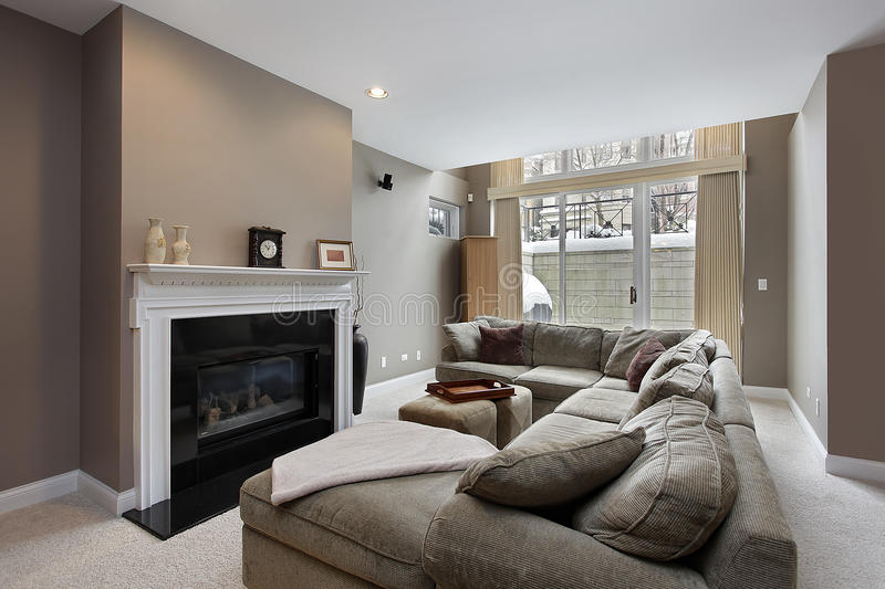 Family room with black fireplace. Family room in city condo with black fireplace stock photos