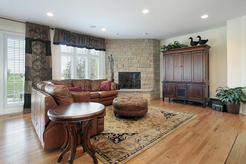 Family room with fireplace. Family room in luxury home with stone fireplace stock image