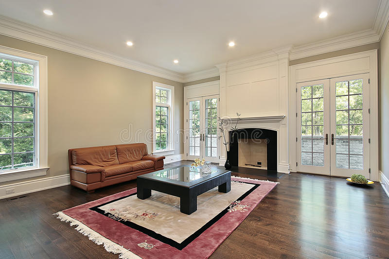 Family room with fireplace. Family room in new construction home with fireplace royalty free stock images