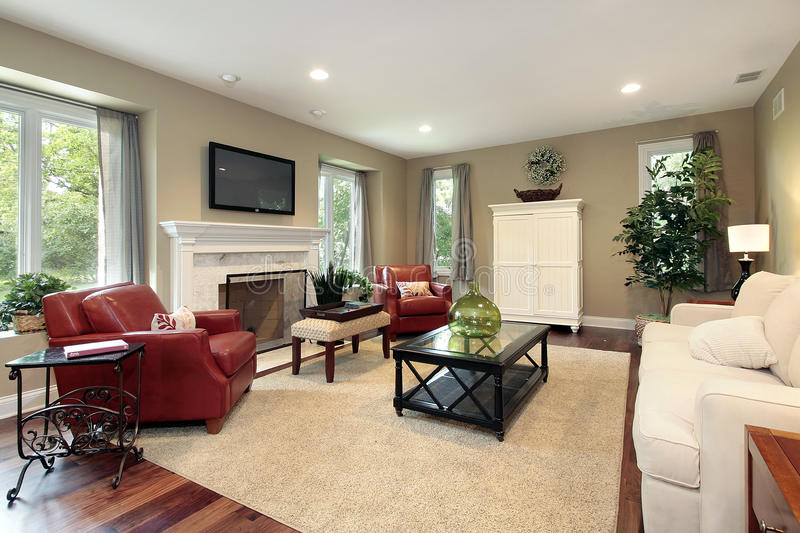 Family room with fireplace. Family room in luxury home with fireplace stock photo
