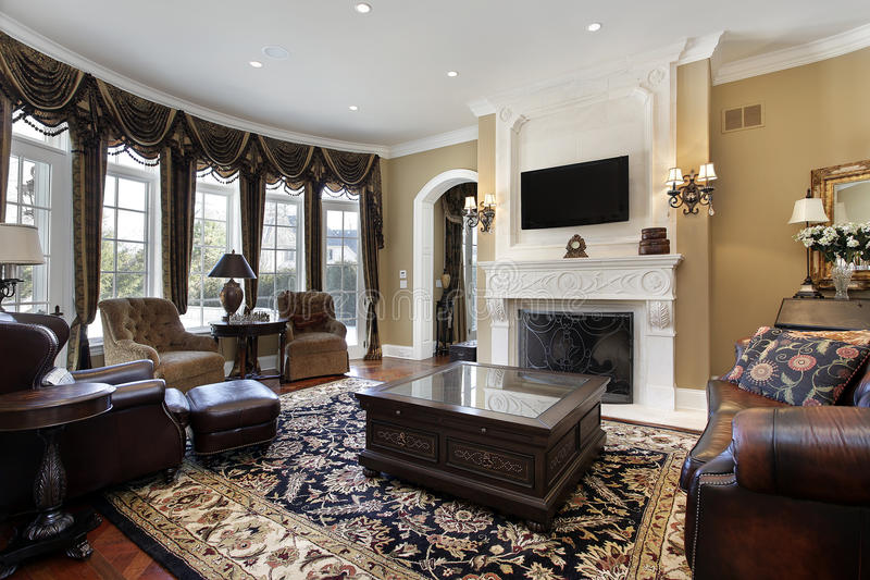 Family room with fireplace. Family room in luxury home with fireplace stock image