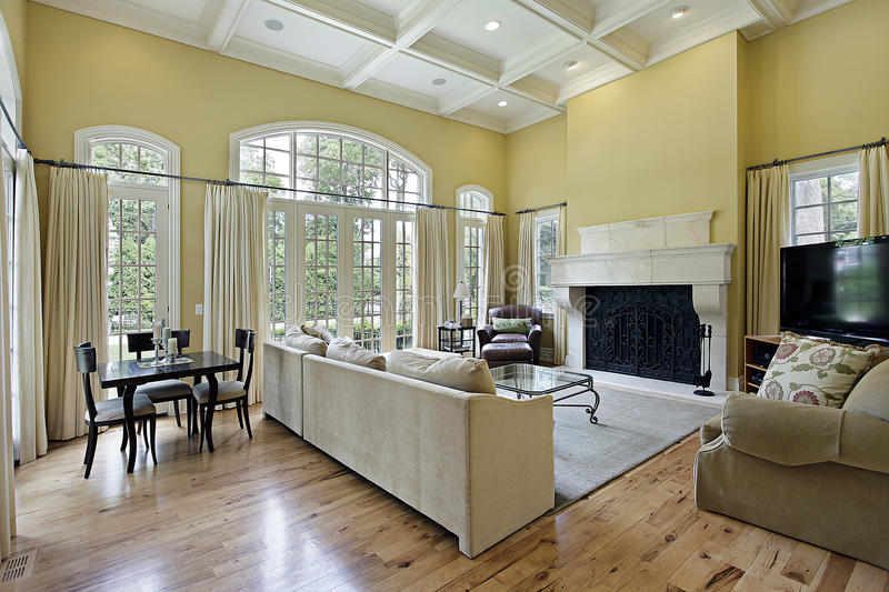 Family room with fireplace. Family room in luxury home with fireplace royalty free stock photos