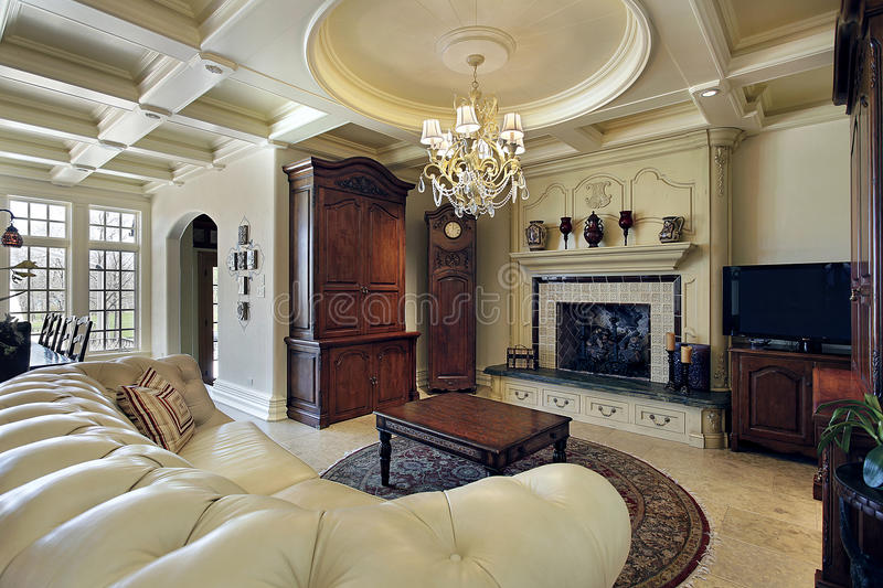Family room with fireplace. Family room in luxury home with fireplace stock photos