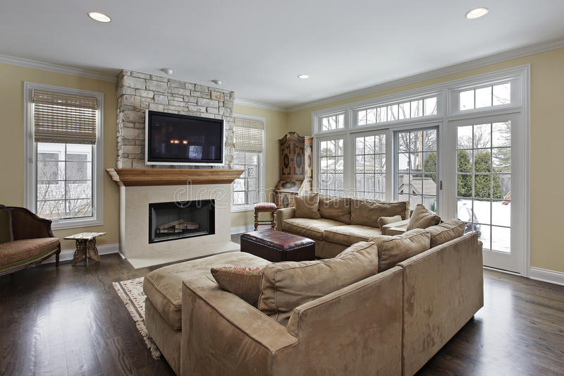 Family room with fireplace. Family room with wood and stone fireplace stock images