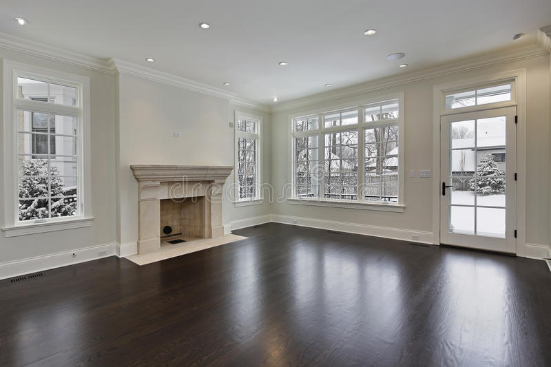 Family room with fireplace. Family room in new construction home with fireplace stock image