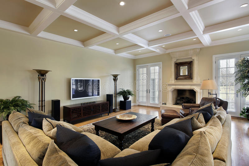 Family room with fireplace. Family room in luxury home with fireplace royalty free stock image