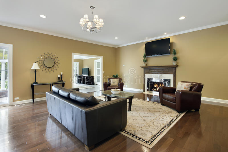 Family room with fireplace. Family room in upscale home with fireplace stock images