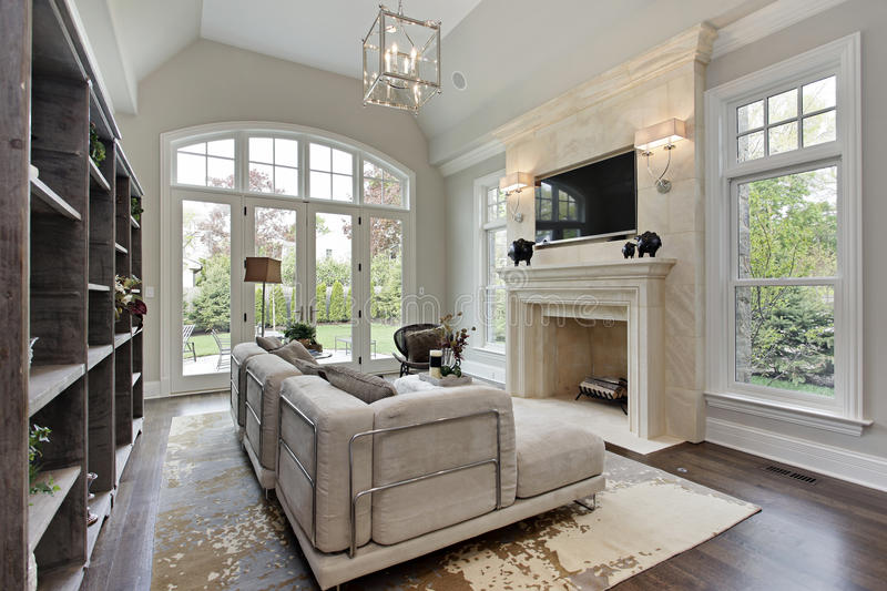 Family room with marble fireplace. Family room in luxury home with marble fireplace stock photos