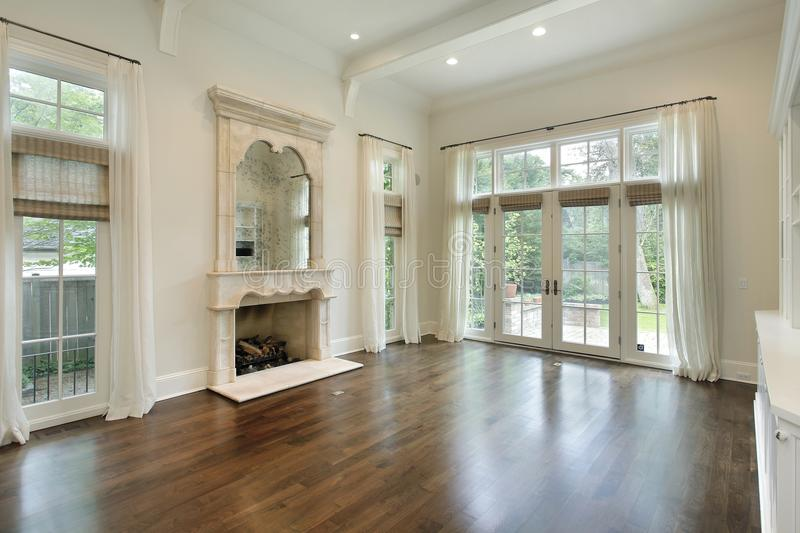 Family room with fireplace. Family room in suburban home with fireplace royalty free stock photo