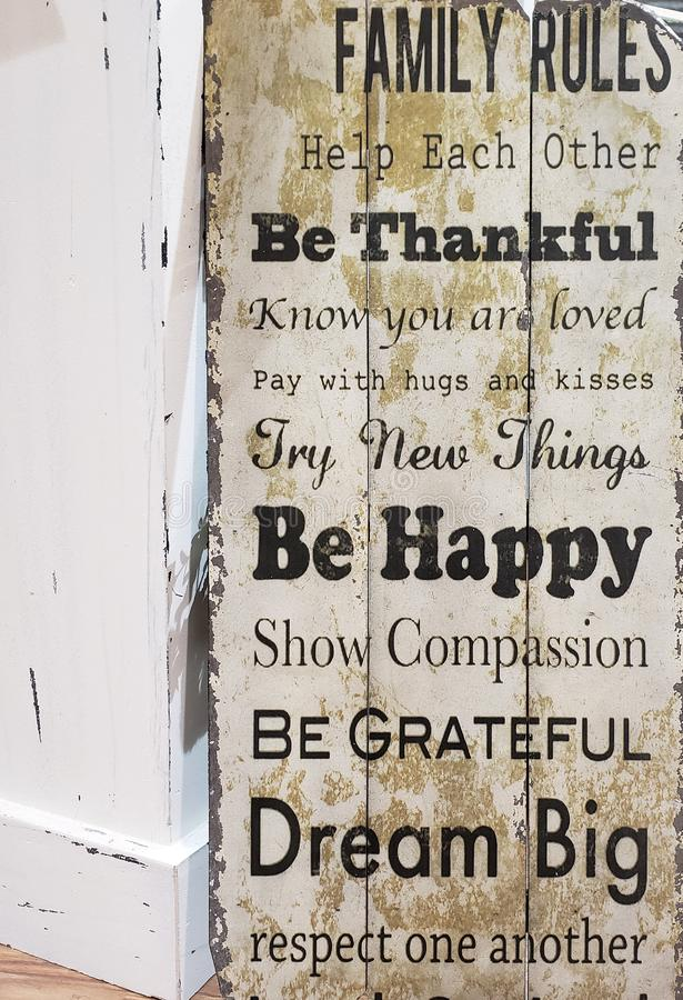 Family rules print on wooden wall background stock images