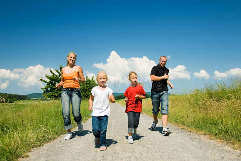 Family running stock image